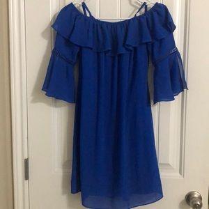 Woman's blue off the shoulder dress